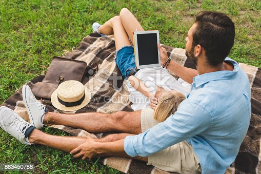 istock young couple with tablet 863450788