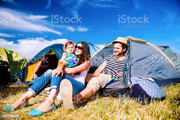 Young Couple With Their Baby Daughter In Tent Summer Stock Photo - Download Image Now
