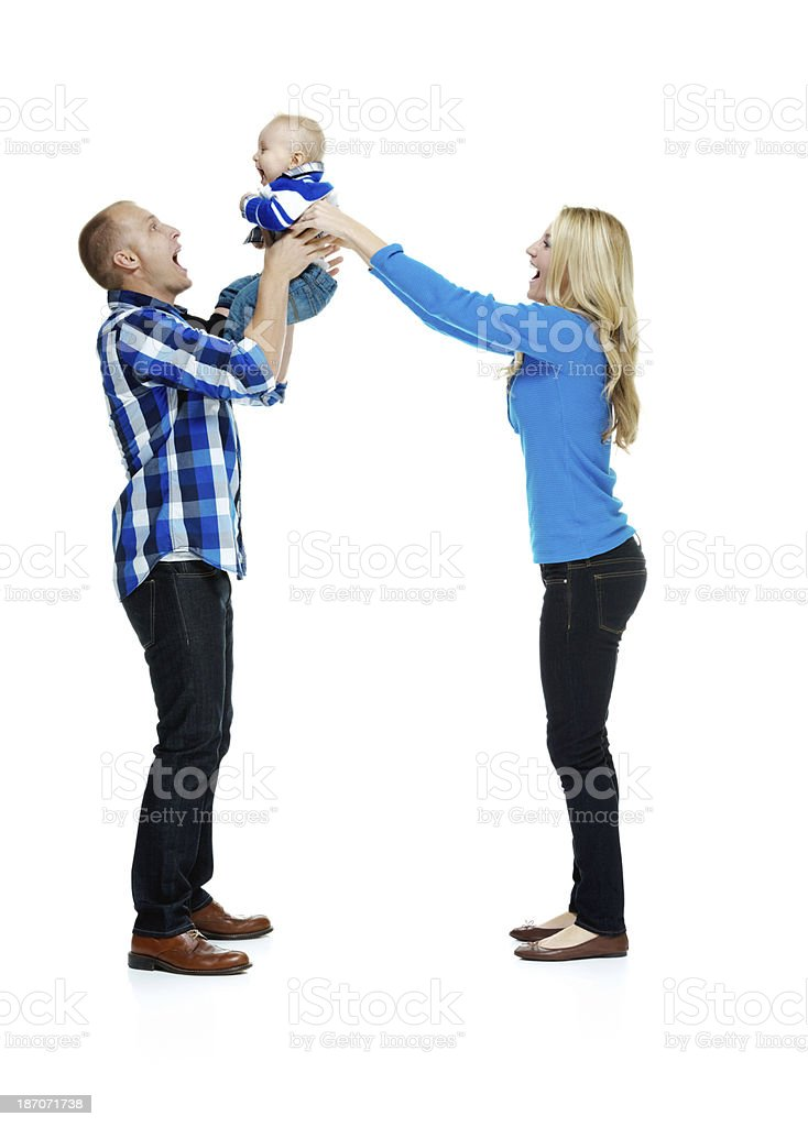 Young couple with their child royalty-free stock photo