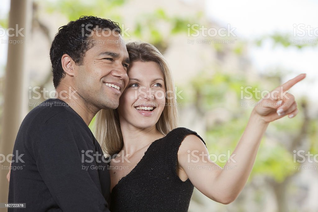 Young couple with woman pointing stock photo
