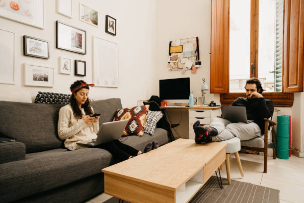 Young couple working from home stock photo