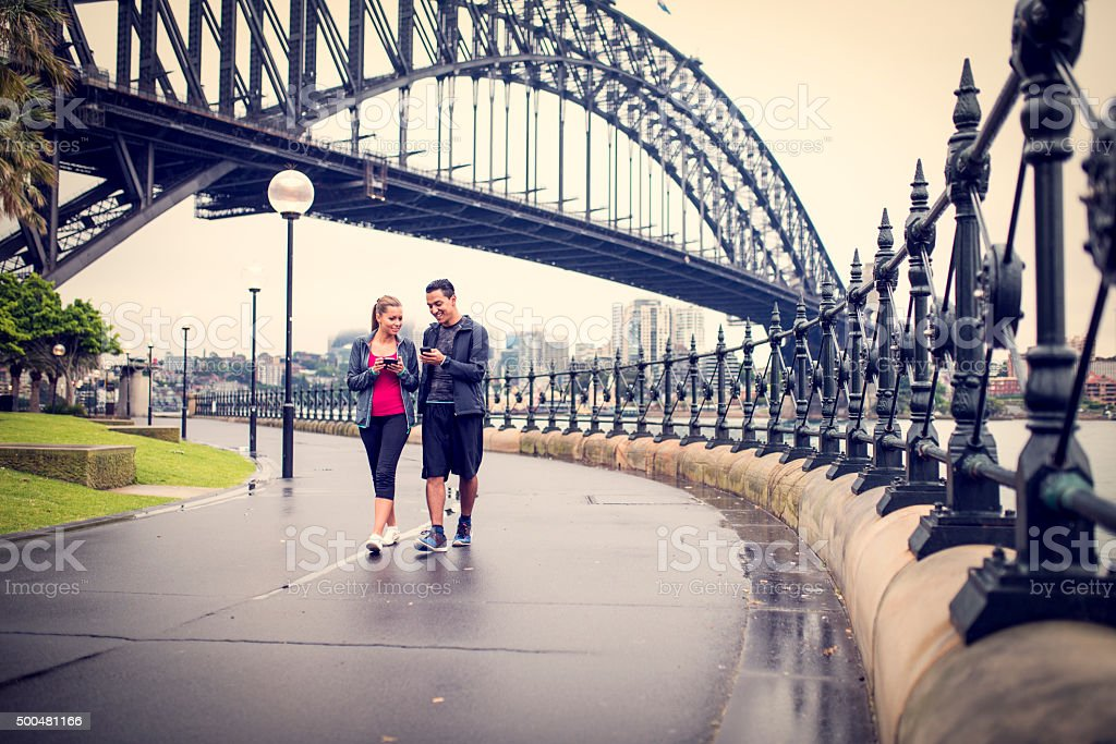 Young couple working out on city street stock photo