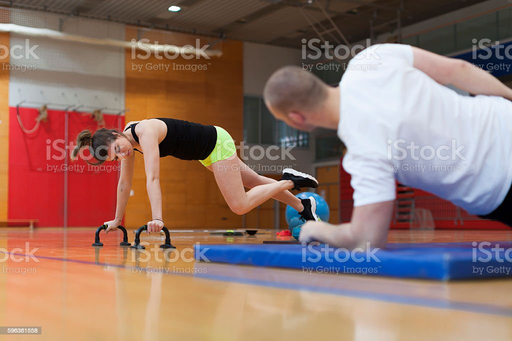 Young Couple Workout in Gym Low Angle View royalty-free stock photo