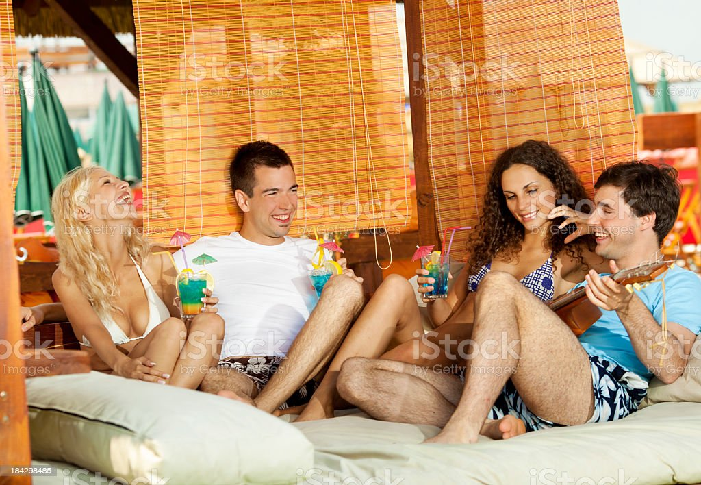 Young Couples at the beach having fun royalty-free stock photo