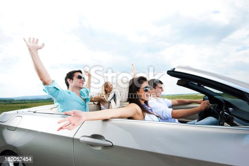 481388538 istock photo Young couples driving in a cabriolet 182052454