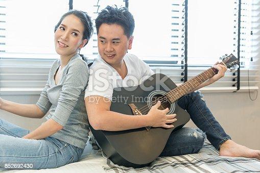 849355030 istock photo Young Couples playing guitar 852692430