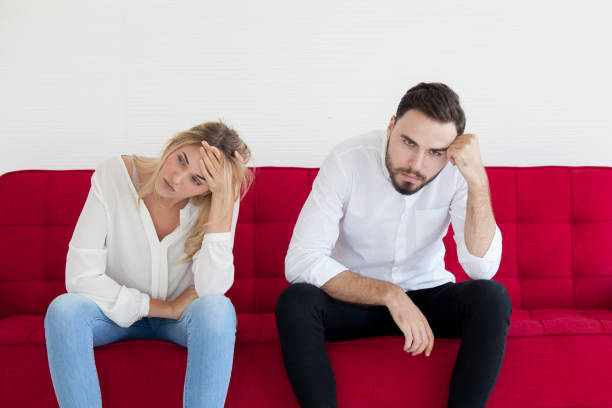 Young couples with boredom sitting on the sofa in the room Young couples with boredom sitting on the sofa in the room background of the sad couple fighting bed stock pictures, royalty-free photos & images