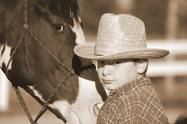 Young Cowboy & Horse stock photo