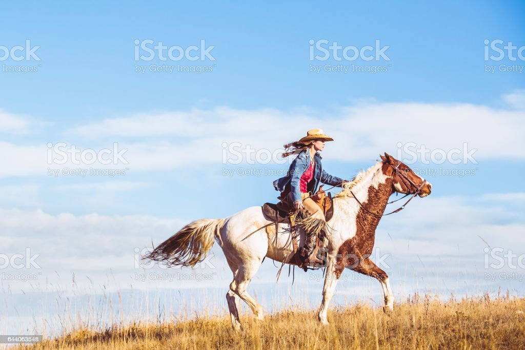 Young Cowgirl On Horseback stock photo