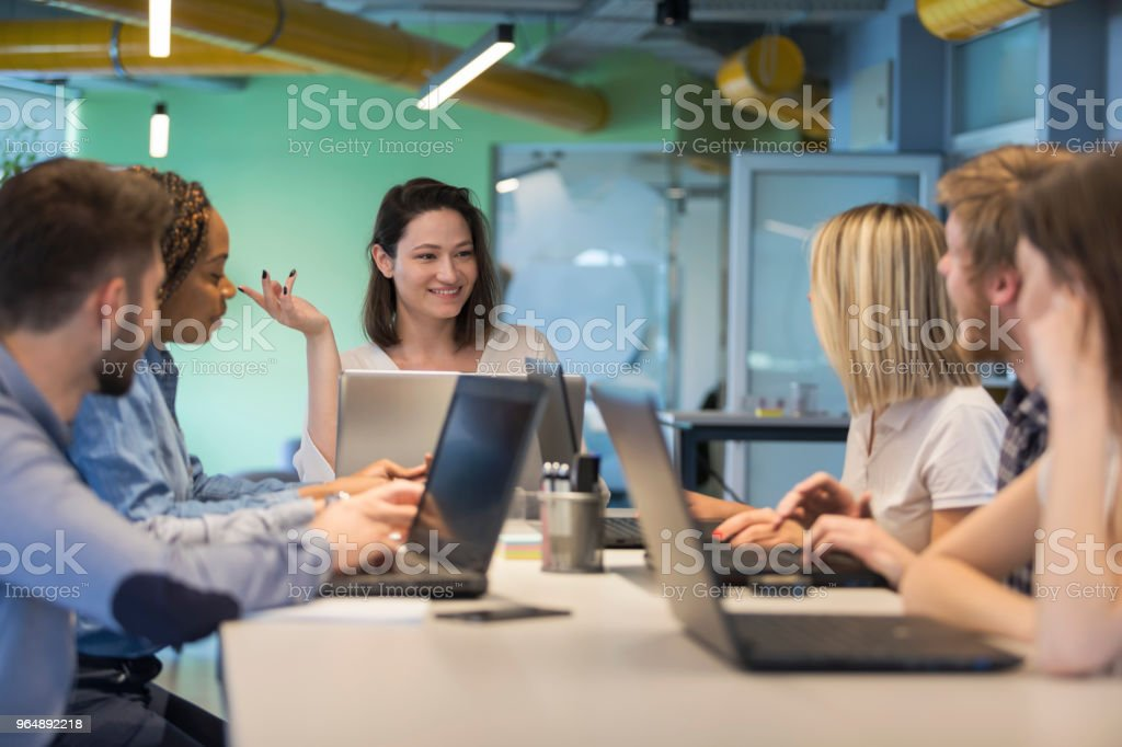 Young coworkers in modern office royalty-free stock photo