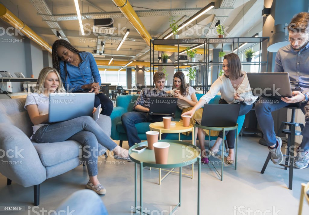 Young coworkers in modern office Young people making strategy for startup business in casual co working space Adult Stock Photo