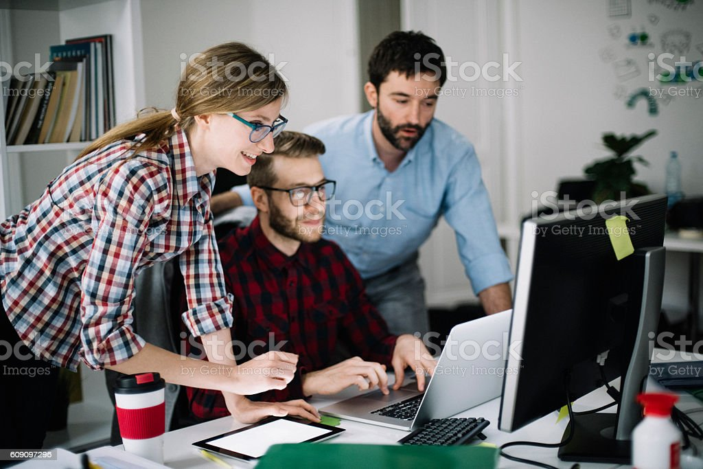 Young co-workers motivated for new project - Photo