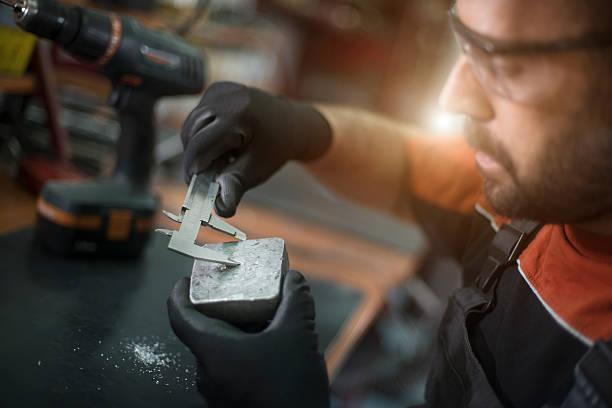 Young craftsman machine piece and repairing stock photo