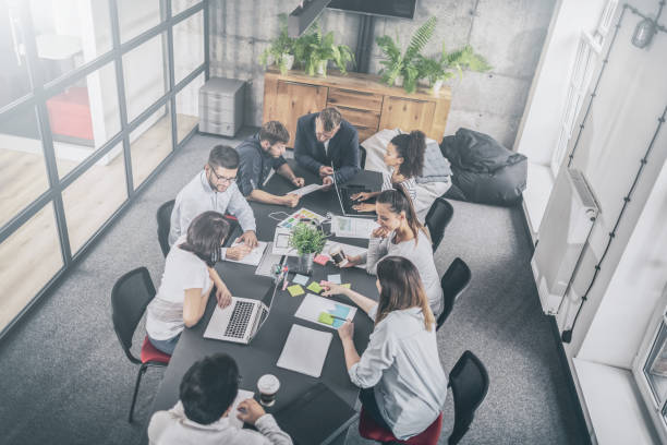 Young creative business people meeting at office. stock photo