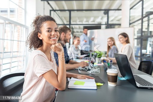 832112086istockphoto Young creative business people meeting at office. 1179185436