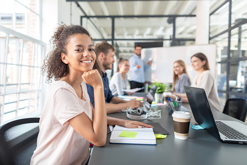 832112086 istock photo Young creative business people meeting at office. 1179185436