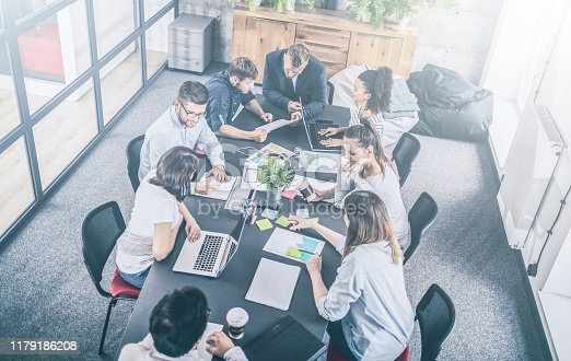 832112086istockphoto Young creative business people meeting at office. 1179186208