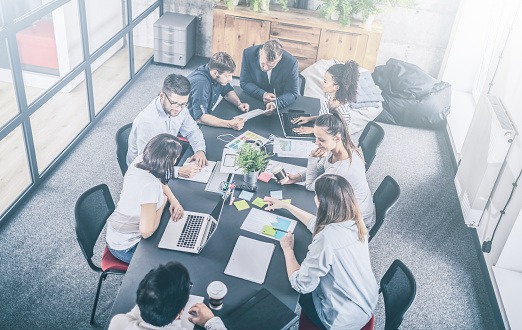 832112086 istock photo Young creative business people meeting at office. 1179186208