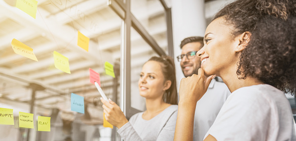 832112086 istock photo Young creative business people meeting at office. 1179186273