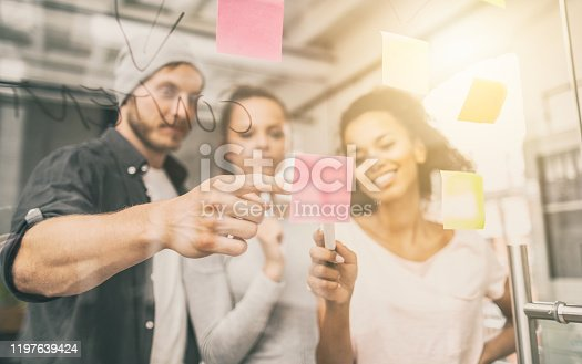 832112086istockphoto Young creative business people meeting at office. 1197639424