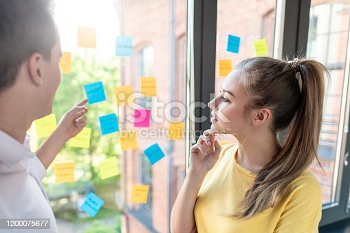 832112086istockphoto Young creative business people meeting at office. 1200075677