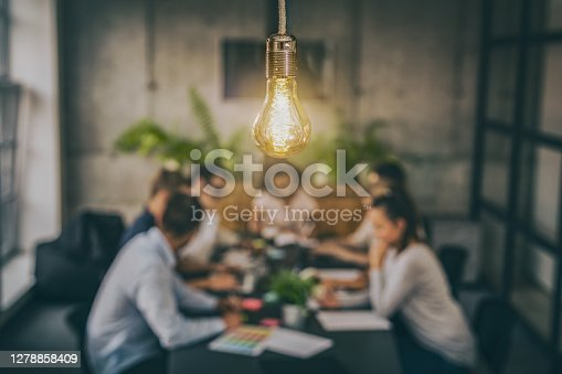 istock Young creative business people meeting at office. 1278858409