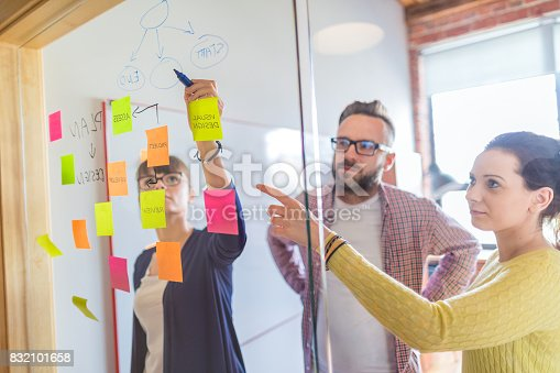 832112086istockphoto Young creative business people meeting at office. 832101658