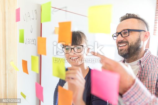 832112086istockphoto Young creative business people meeting at office. 832102006