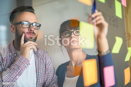 832112086istockphoto Young creative business people meeting at office. 840607120