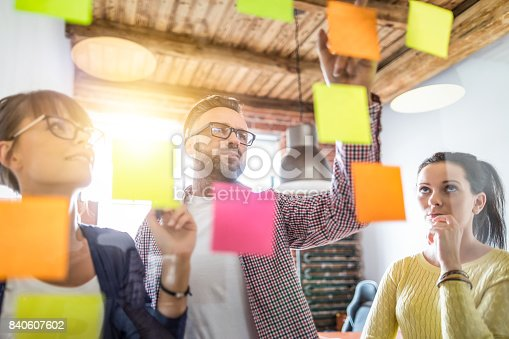 832112086istockphoto Young creative business people meeting at office. 840607602