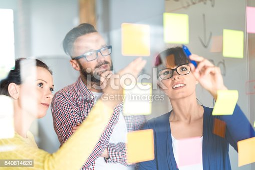 832112086istockphoto Young creative business people meeting at office. 840614620