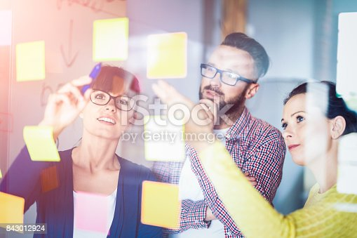 832112086istockphoto Young creative business people meeting at office. 843012924