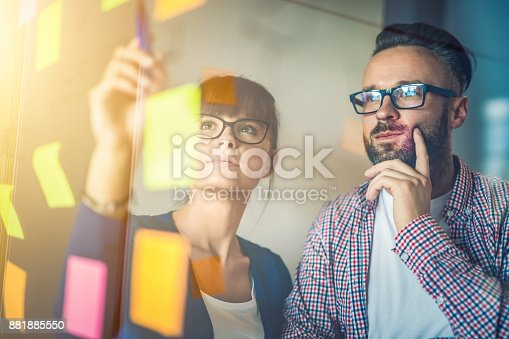 832112086istockphoto Young creative business people meeting at office. 881885550
