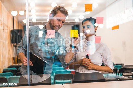 832112086istockphoto Young creative business people meeting at office 956479506