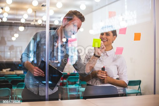 832112086istockphoto Young creative business people meeting at office 956479508