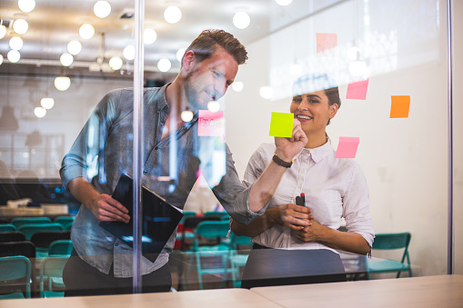832112086 istock photo Young creative business people meeting at office 956479508