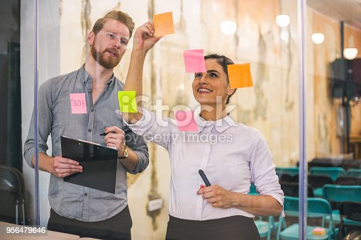 832112086istockphoto Young creative business people meeting at office 956479646