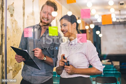 832112086istockphoto Young creative business people meeting at office 956479648