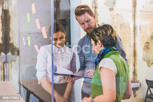 832112086istockphoto Young creative business people meeting at office 956479952