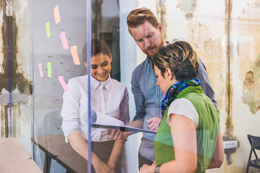 832112086 istock photo Young creative business people meeting at office 956479952