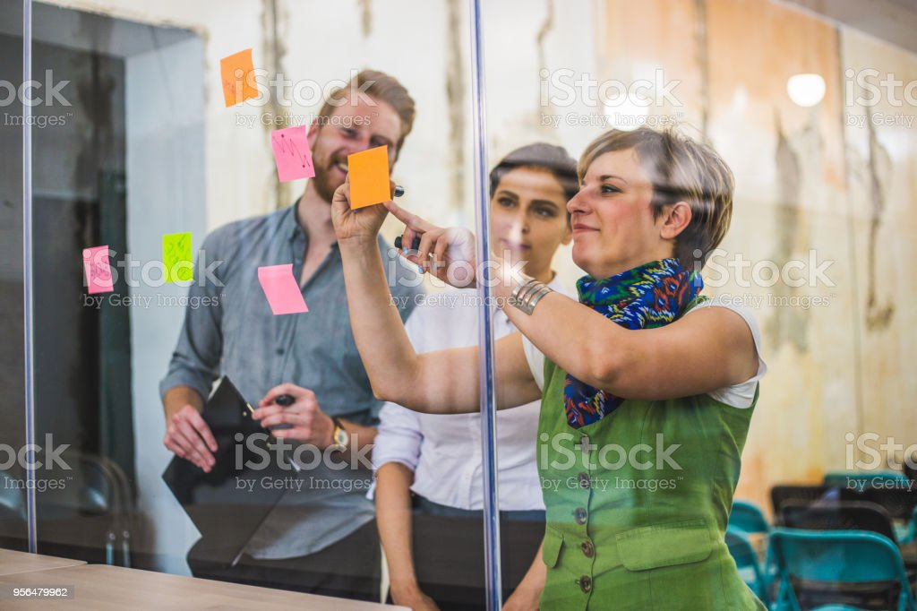 Young creative business people meeting at office stock photo