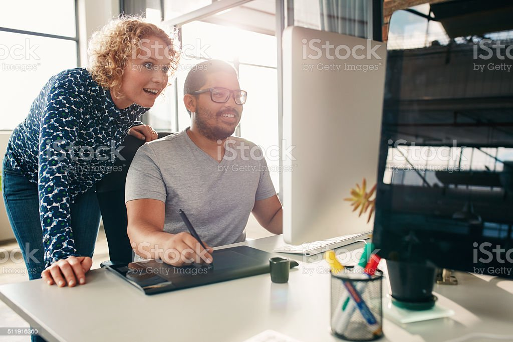 Young creative people working together in office stock photo