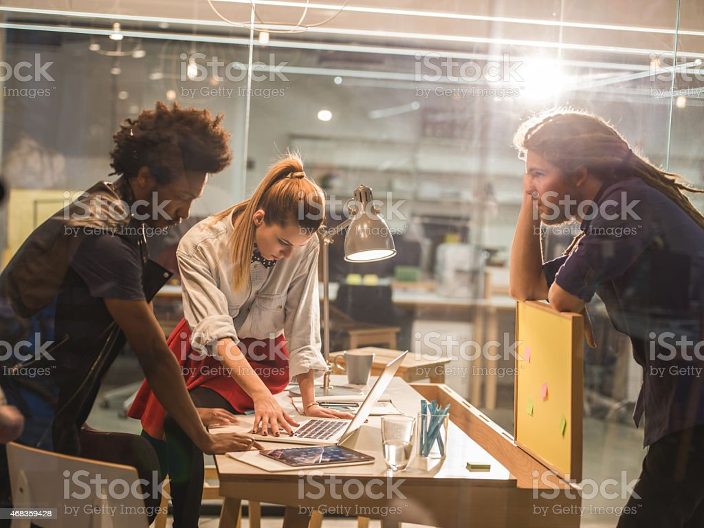 Young creative people working together in the office. royalty-free stock photo