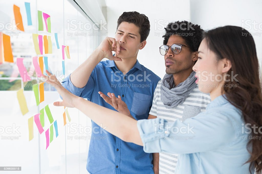 Young creative team brainstorming together stock photo