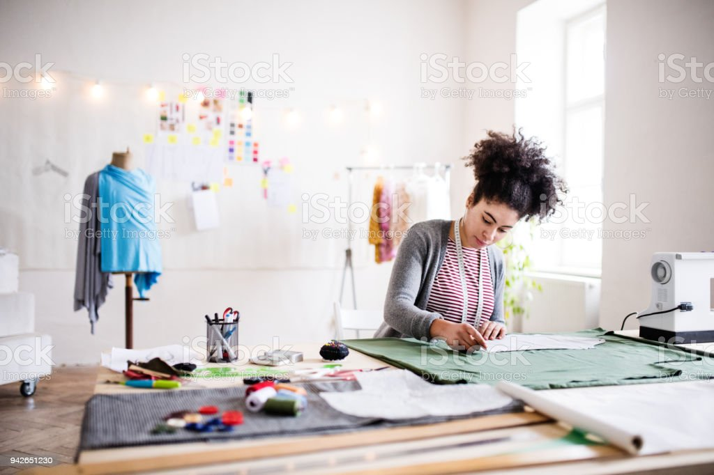 Young creative woman in a studio, startup business. stock photo