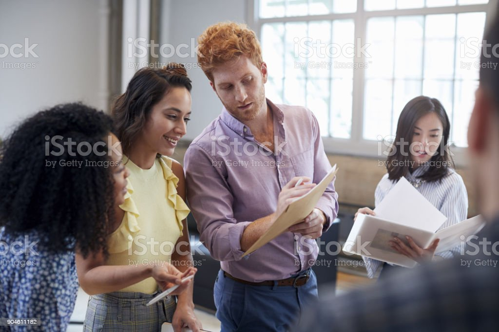 Young creatives discussing brainstorm ideas, close up stock photo