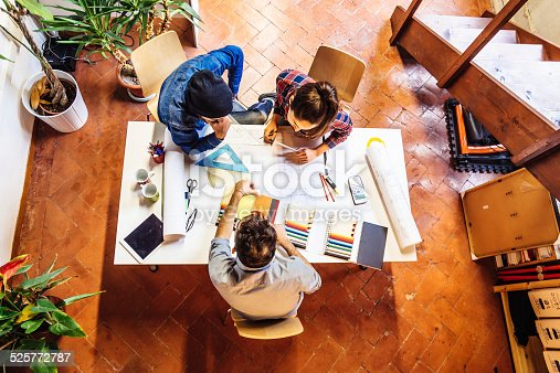 istock Young Creatives Team Working Together 525772787