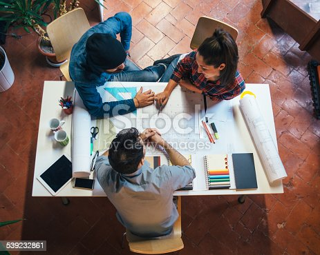 istock Young Creatives Team Working Together 539232861