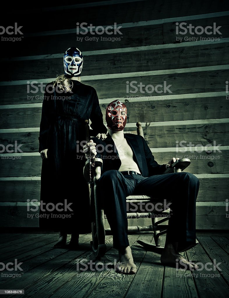 young creepy couple in their cabin porch royalty-free stock photo