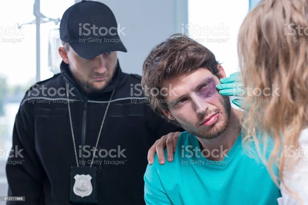 Young criminal in hospital stock photo